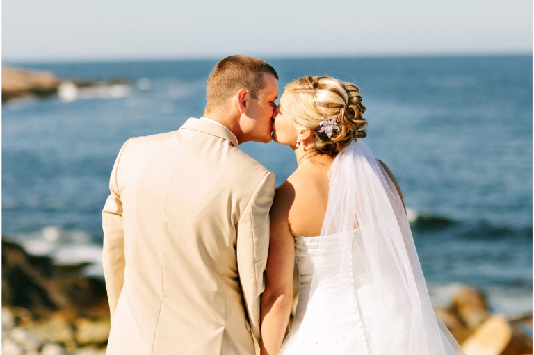 Newlyweds kissing in Rockport, Massachusetts