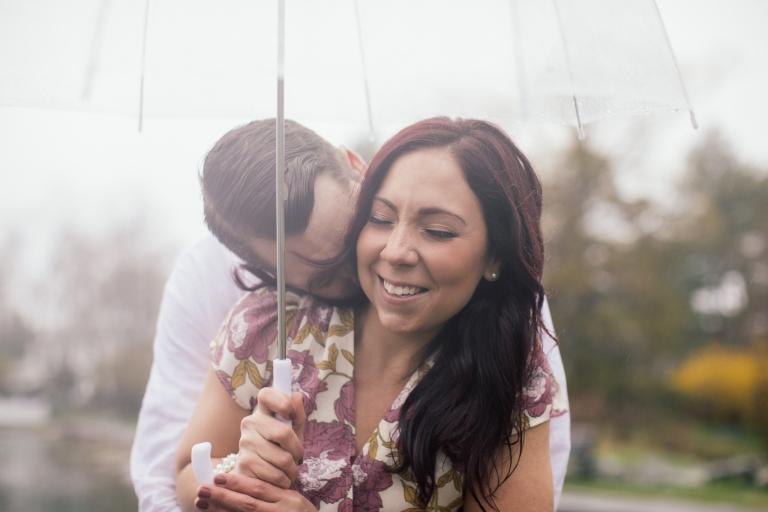 Engaged Couple Kissing Neck