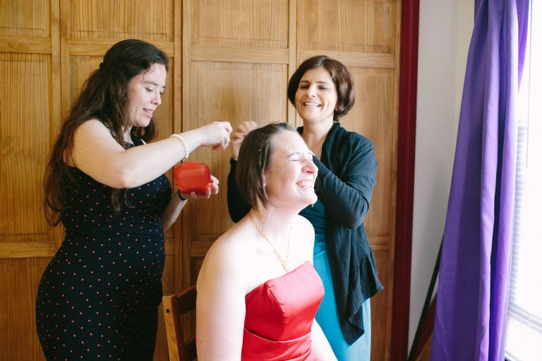 Bride laughing with friends before wedding