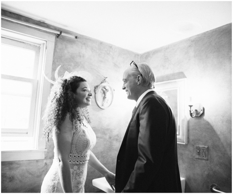 Bride and groom smile nervously at each other before their Herb Lyceum Wedding