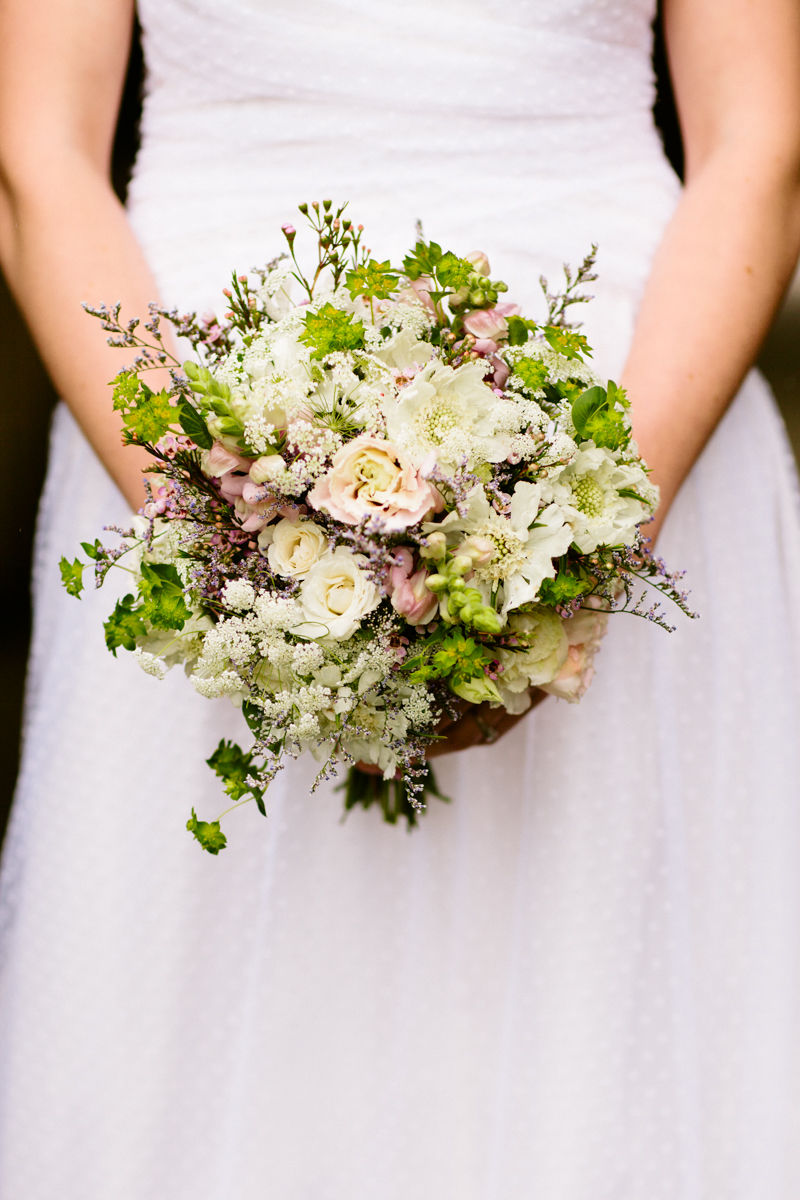 Bride holding a wildflower bouquet at a Plimoth Plantation wedding